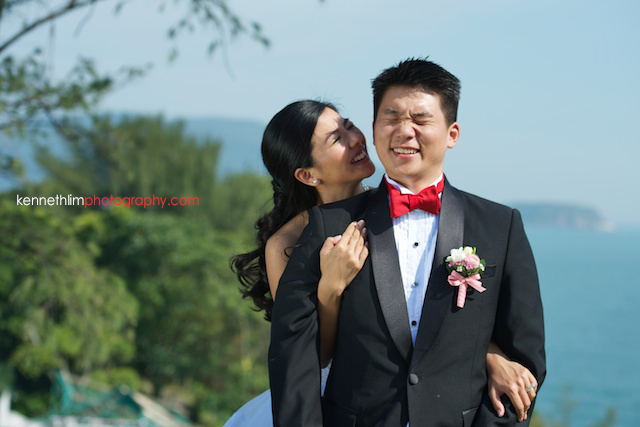 Hong Kong wedding Shek O Golf and Country Club ceremony groom and bride portrait session bride hugging groom from back laughing together