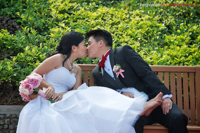 Hong Kong wedding Shek O Golf and Country Club ceremony groom and bride portrait session sitting on bench kissing