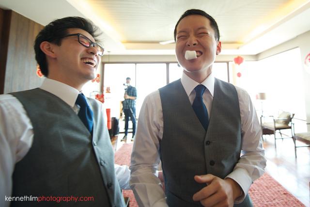 Koh Samui wedding Shasa Resort groomsmen playing games and laughing
