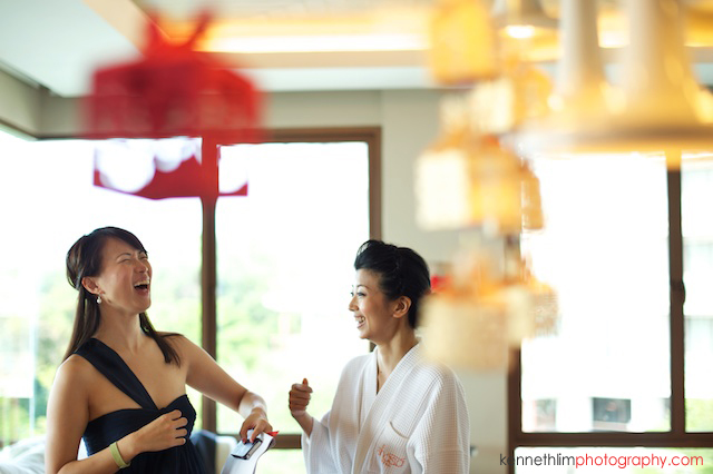 Koh Samui wedding Shasa Resort morning preparations bride and bridesmaid talking and laughing