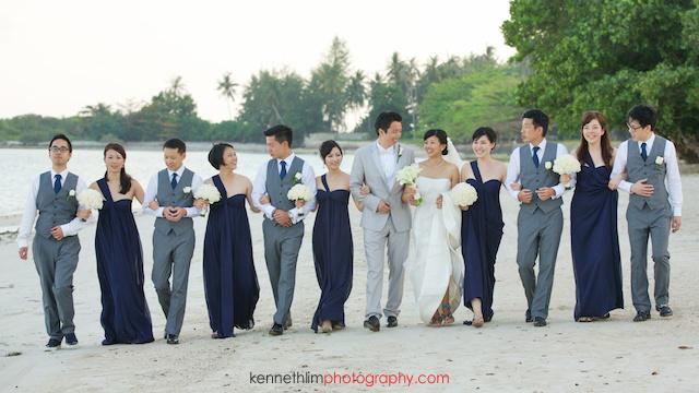 Koh Samui wedding YL Residence bride and groom and bridesmaids groomsmen portrait walking on beacharms locked