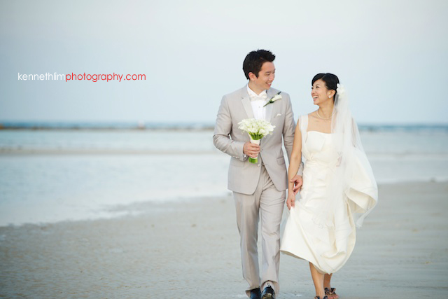 Koh Samui wedding YL Residence bride and groom outdoor portrait session holding hands walking down the beach