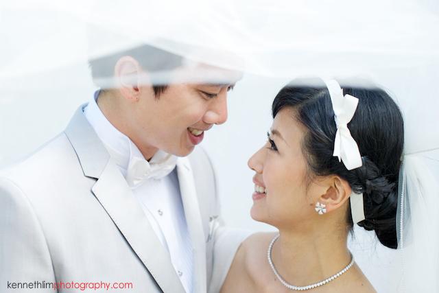 Koh Samui wedding YL Residence bride and groom outdoor portrait session under brides wedding veil
