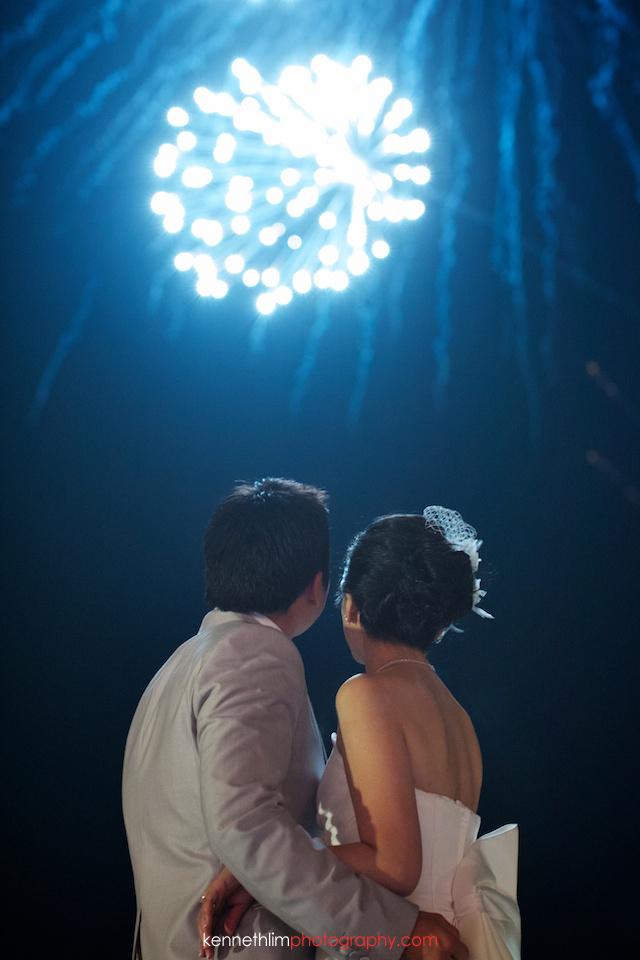Koh Samui wedding YL Residence bride and groom outdoor watching fireworks hugging