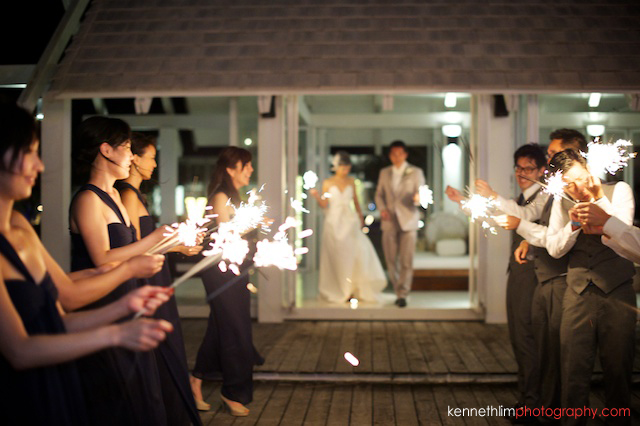 Koh Samui wedding YL Residence bride and groom walking out greeted by sparklers