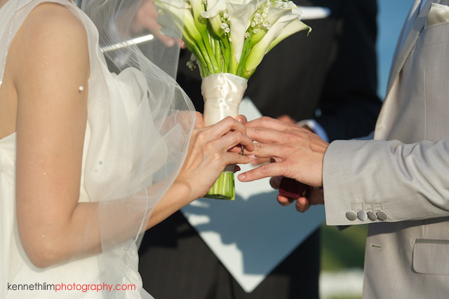 Koh Samui wedding YL Residence bride putting ring on groom