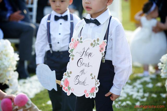 Koh Samui wedding YL Residence ring boy walking with sign