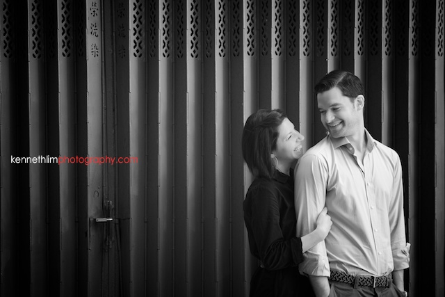 Hong Kong engagement photoshoot outdoors couple hugging and smiling black and white