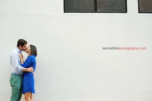 Hong Kong engagement photoshoot outdoors couple kissing in front white wall