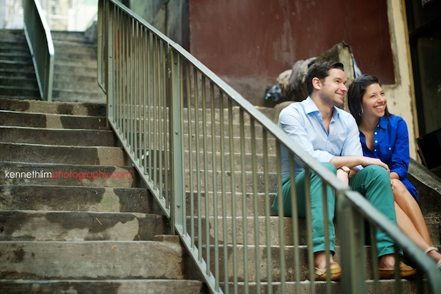 Hong Kong engagement photoshoot outdoors couple laughing holding hands sitting on stairs