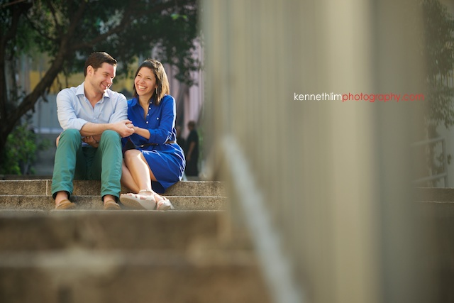 Hong Kong engagement photoshoot outdoors couple laughing sitting on stairs