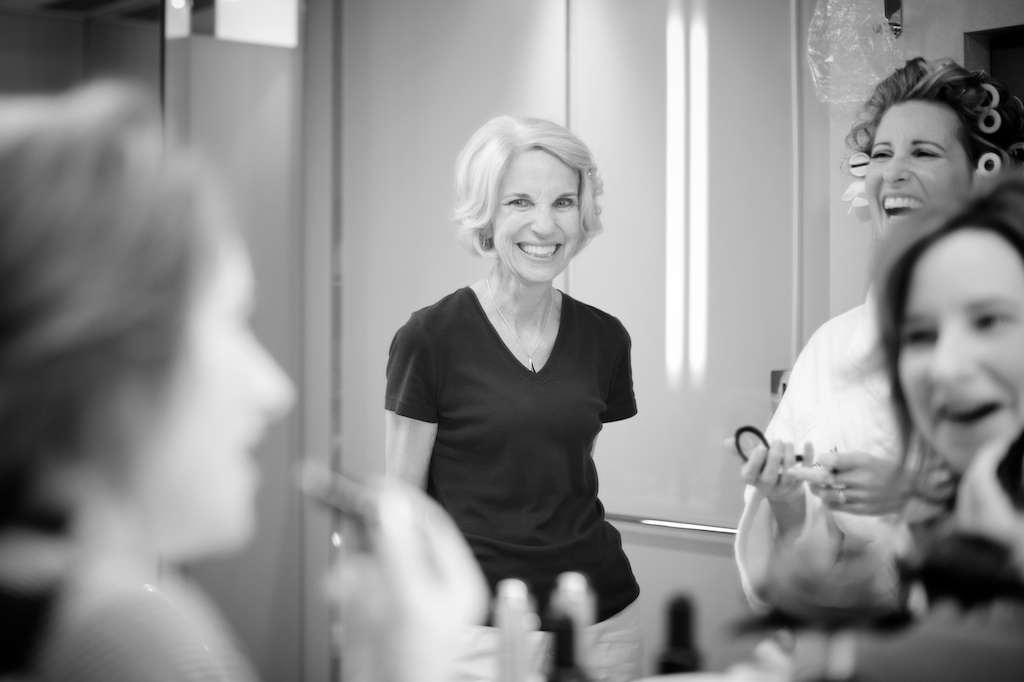 Hong Kong Novotel wedding photography morning mother getting ready smiling with bride