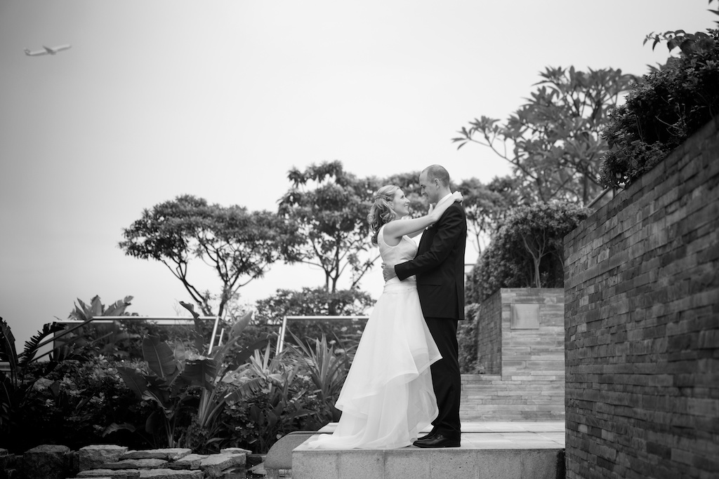 Hong Kong Novotel wedding photography portraits bride and groom hugging