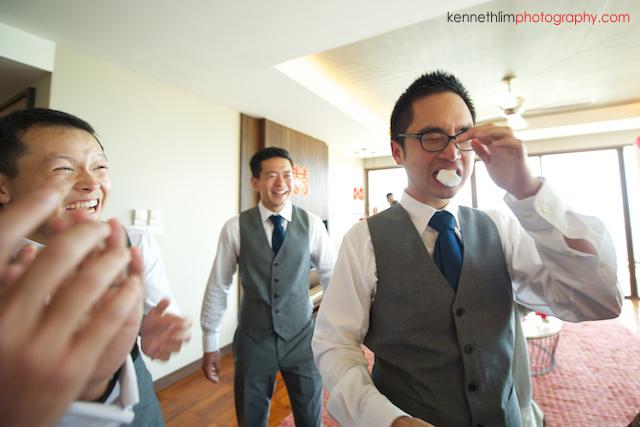 Koh Samui wedding Shasa Resort groomsmen playing games and laughing tears in eyes