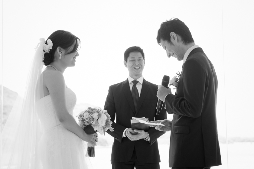 Hong Kong Wedding Photography Discovery Bay Auberge White Chapel groom giving vows to bride laughing