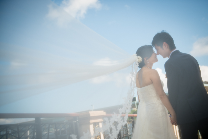 Hong Kong Wedding Photography Discovery Bay Auberge White Chapel bride groom kissing behind veil