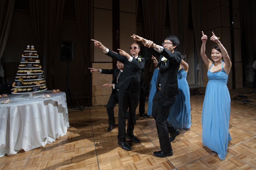 Hong Kong Wedding Photography Four Seasons banquet wedding party dancing together pointing
