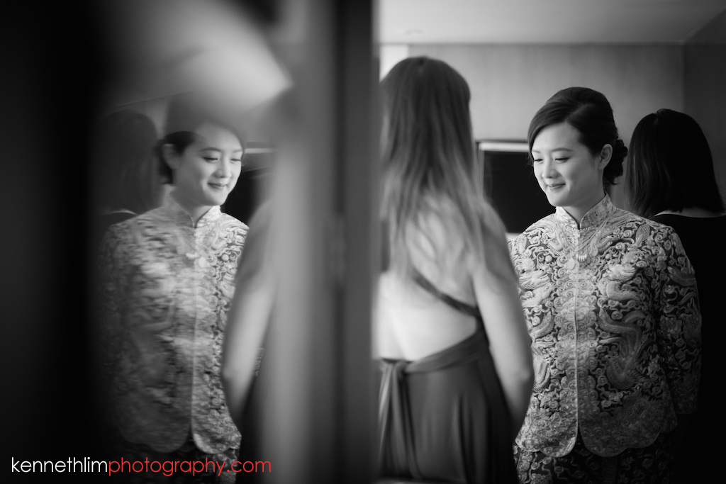 Hong Kong wedding photography big day morning bride getting ready with traditional chinese wedding dress brides maid helping out