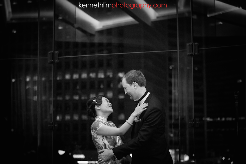 Hong Kong Club wedding day photography big day evening banquet groom and bride kissing hugging after ring exchange