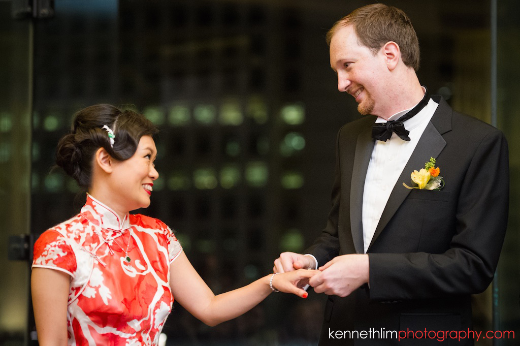 Hong Kong Club wedding day photography big day evening banquet groom and bride exchanging rings smiling together
