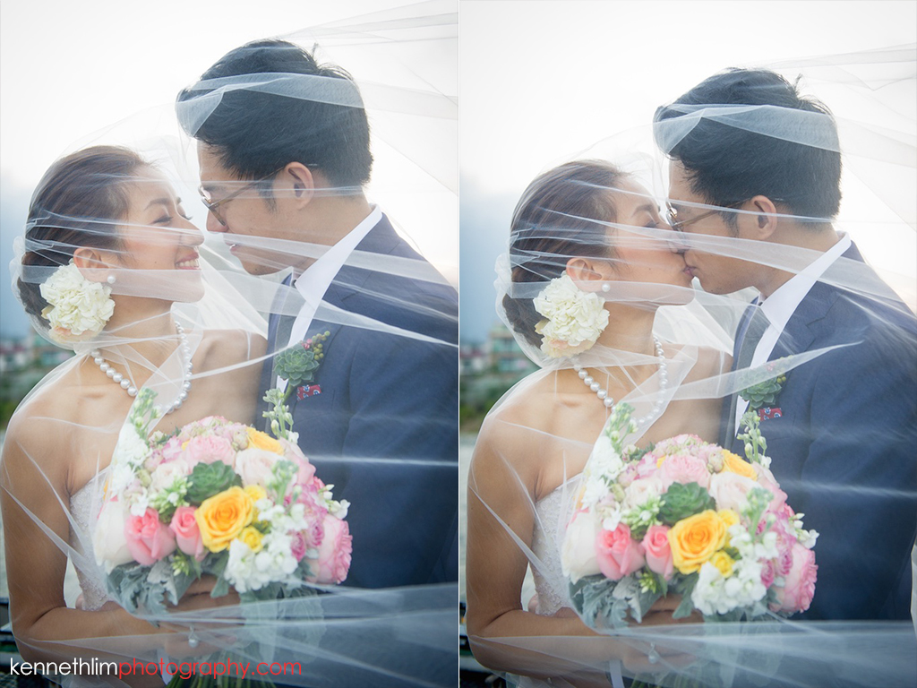 Hong Kong Wedding photography one thirty one bride groom portrait session kissing together under wedding veil