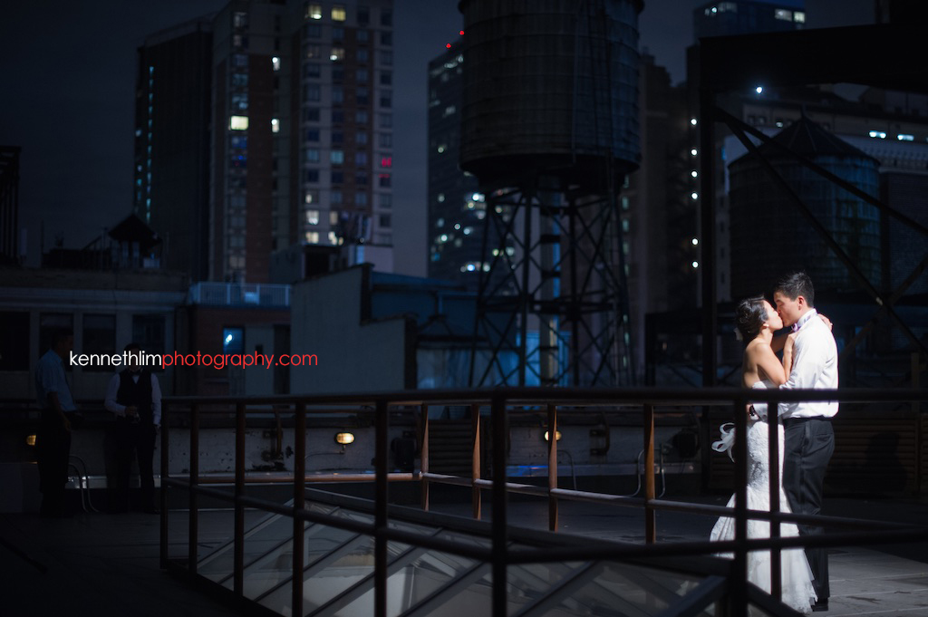 NYC Garys Loft wedding day photography evening portrait session bride groom kissing on rooftop outdoor
