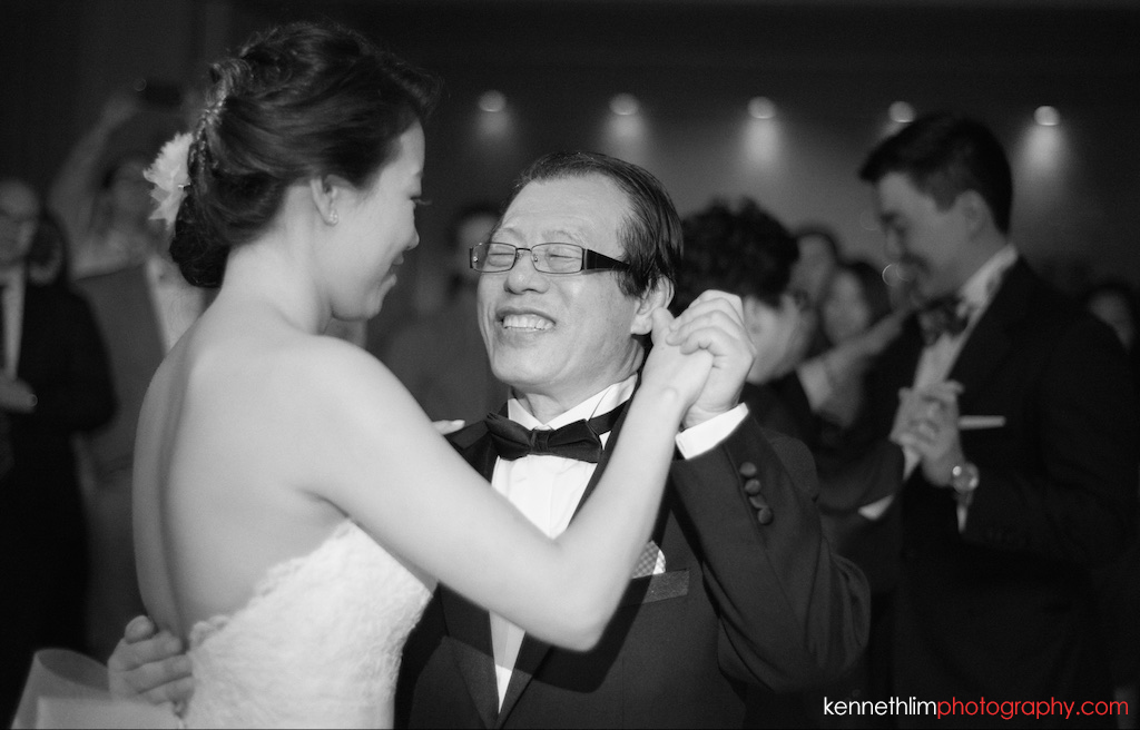 NYC Garys Loft wedding day photography evening bride and father dancing laughing together