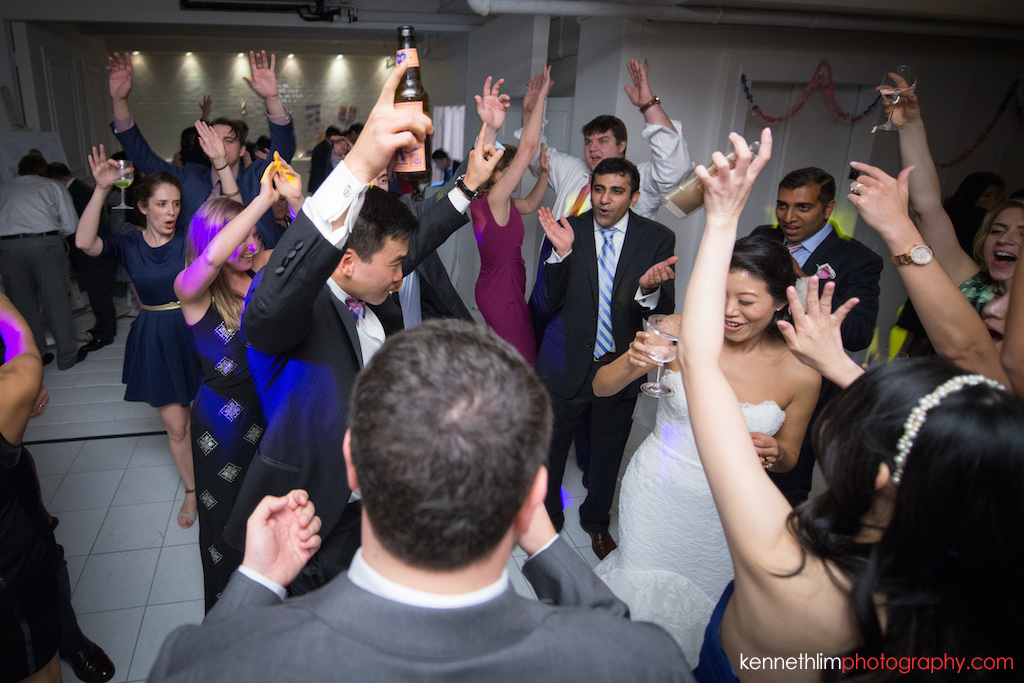 NYC Garys Loft wedding day photography bride and groom toasting to guests on the dance floor