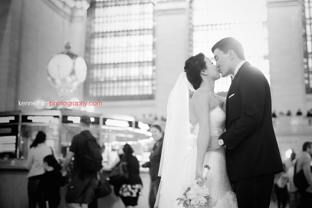 New York City Grand Central Station wedding day photography bride groom portrait session kissing