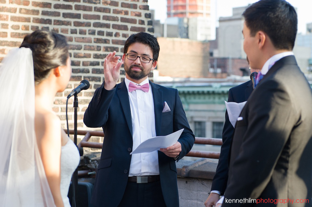 New York City Garys Loft wedding day photography rooftop outdoor ceremony ring exchange between bride and groom