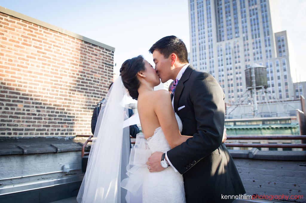 New York City Garys Loft wedding day photography outdoor rooftop ceremony bride and groom first kiss after vows