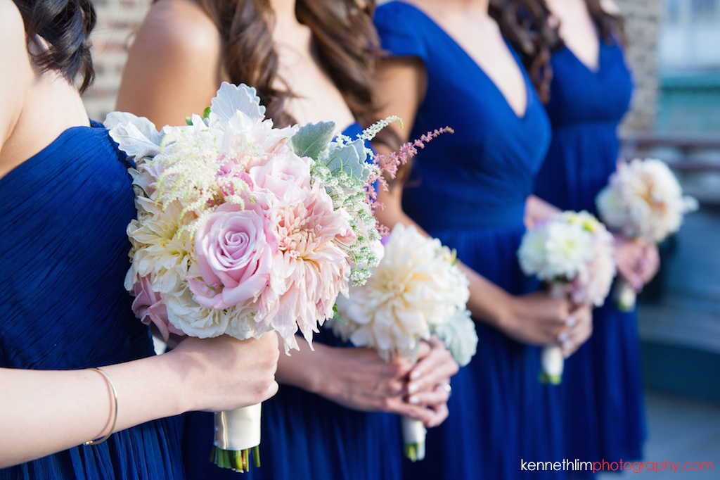New York City Garys Loft wedding day photography ceremony flowers held by bridesmaids