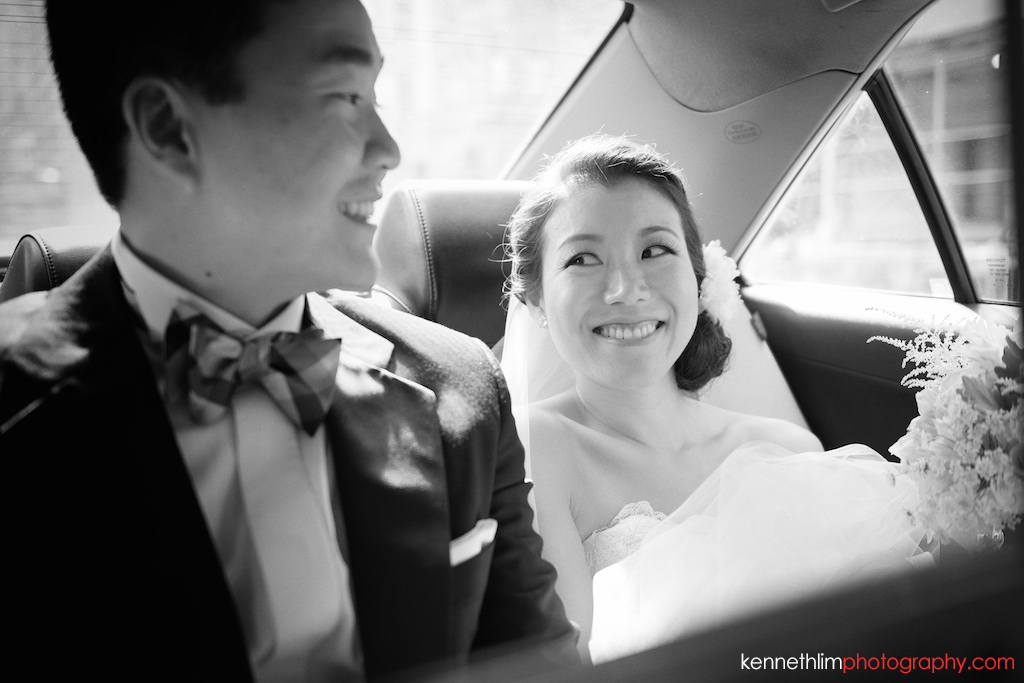 New York City Garys Loft wedding day photography bride groom riding car to venue smiling together
