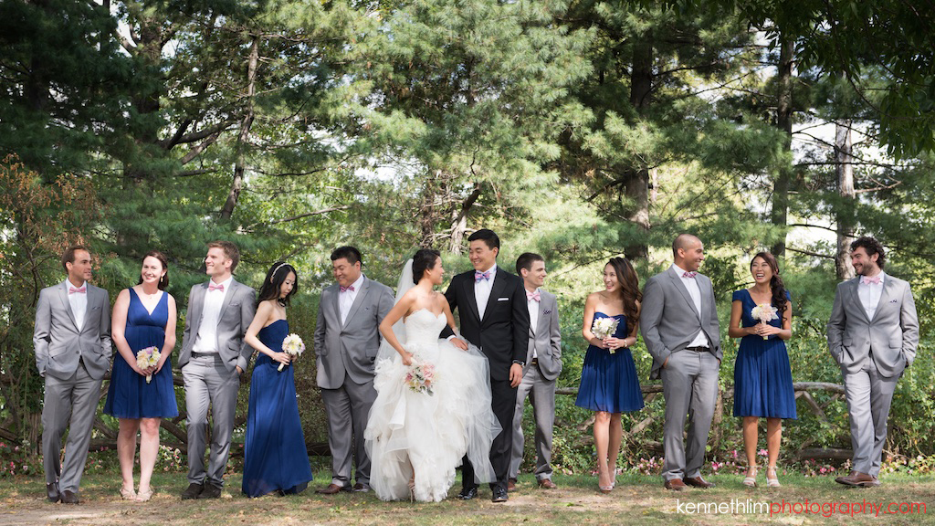 New York City Central Park wedding day photography bridal party outdoor portrait session laughing together