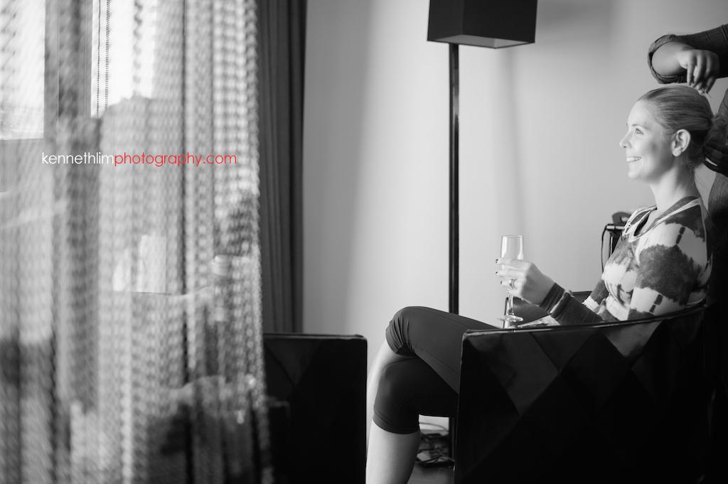 Atlanta wedding W Atlanta Hotel big day photography bridesmaid getting ready in morning drinking champagne