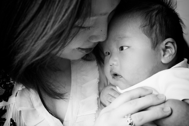 Hong Kong mother holding newborn baby boy