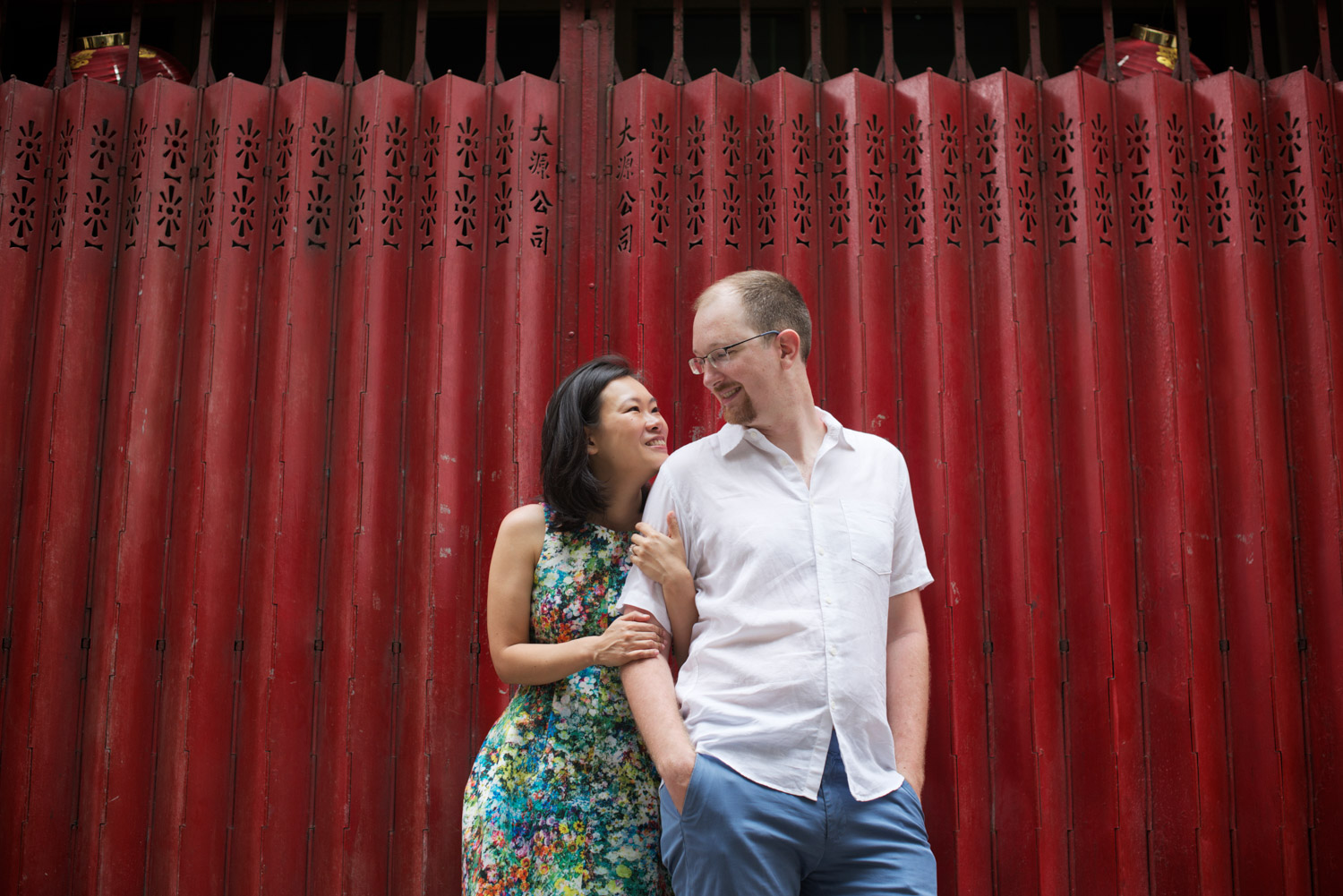 hong-kong-pre-wedding-engagement-photographer-couple-laughing-together-red-gate-soho-central.jpg