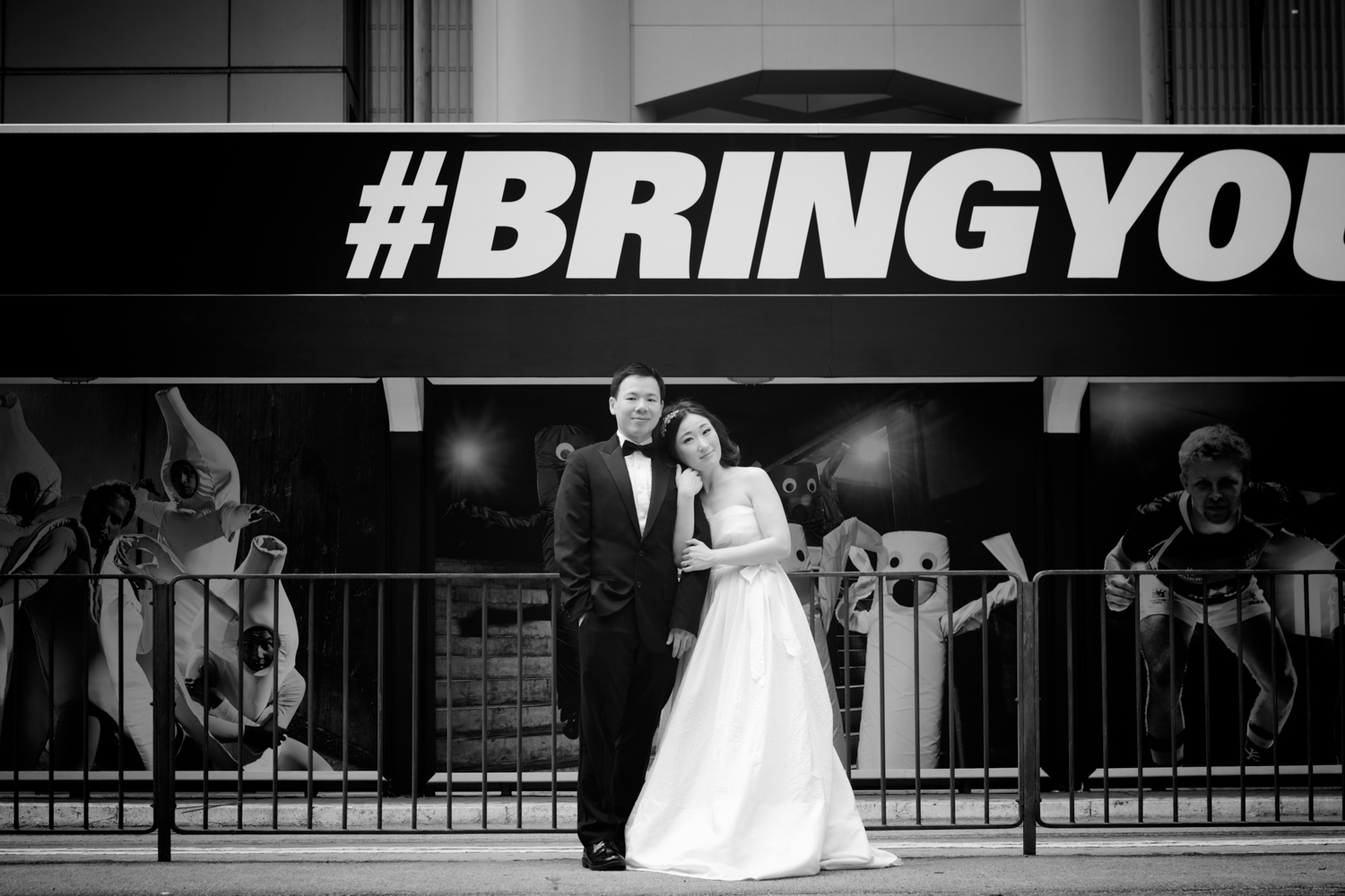 hong-kong-pre-wedding-photographer-couple-in-front-of-tram-black-and-white-central-hsbc-building.jpg