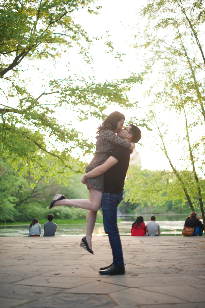 new-york-engagement-photographer-central-park-couple-kissing-in-air-together.jpg