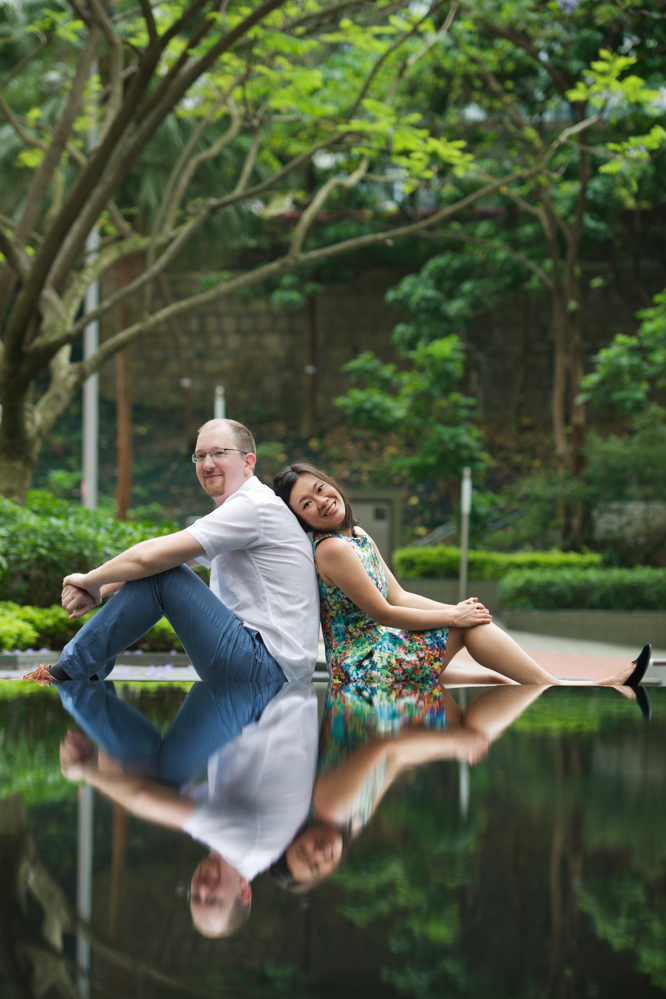 hong-kong-pre-wedding-engagement-photographer-couple-sitting-with-water-reflection-hong-kong-park.jpg