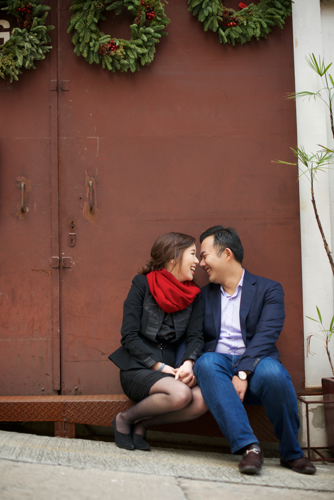 hong-kong-pre-wedding-engagement-photographer-couple-smiling-together-leaning-in-soho-central.jpg