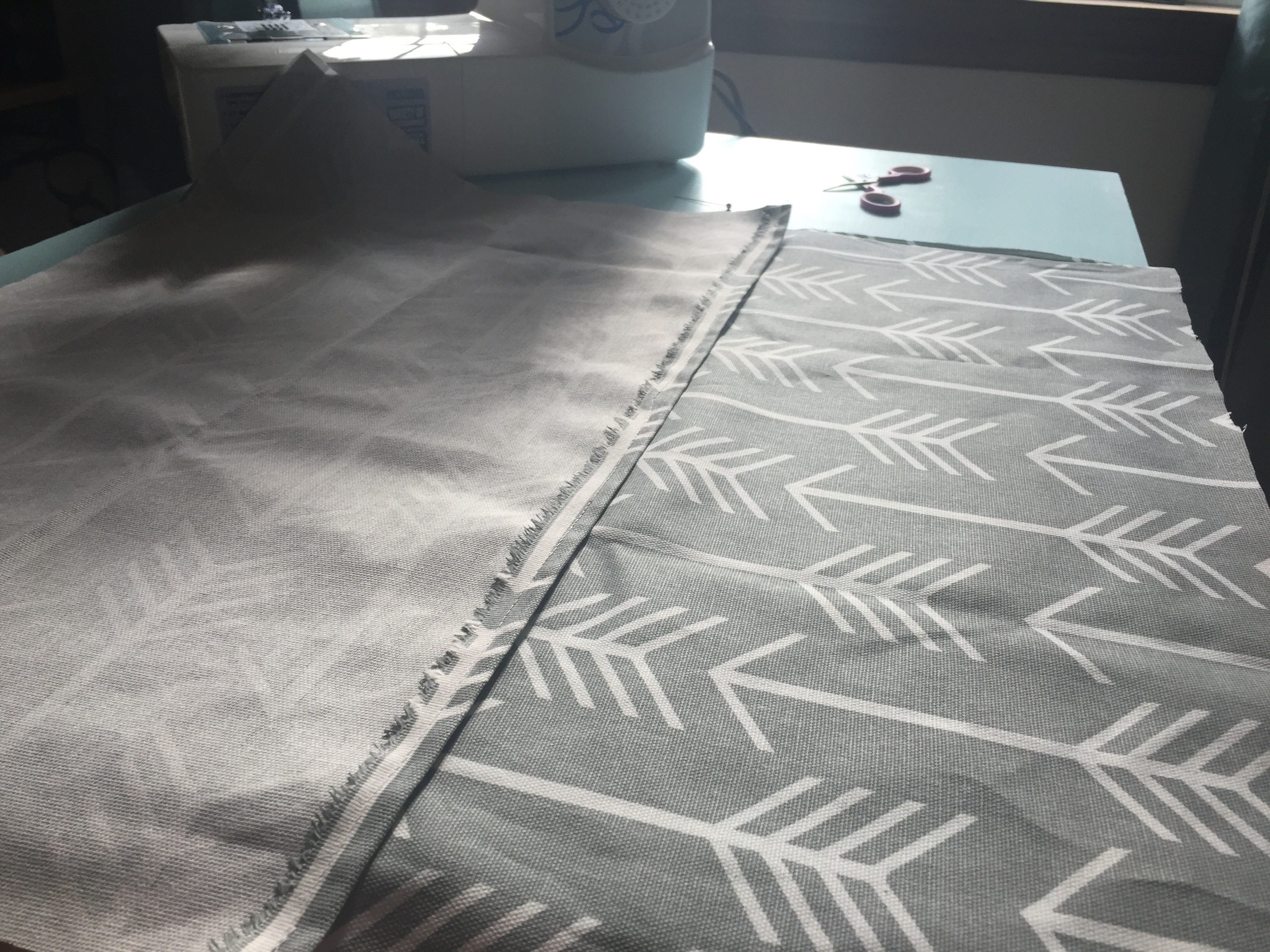 Lay your large piece on table front side up then place your envelope pieces on top of large piece back side up with sewn stitch in middle.
