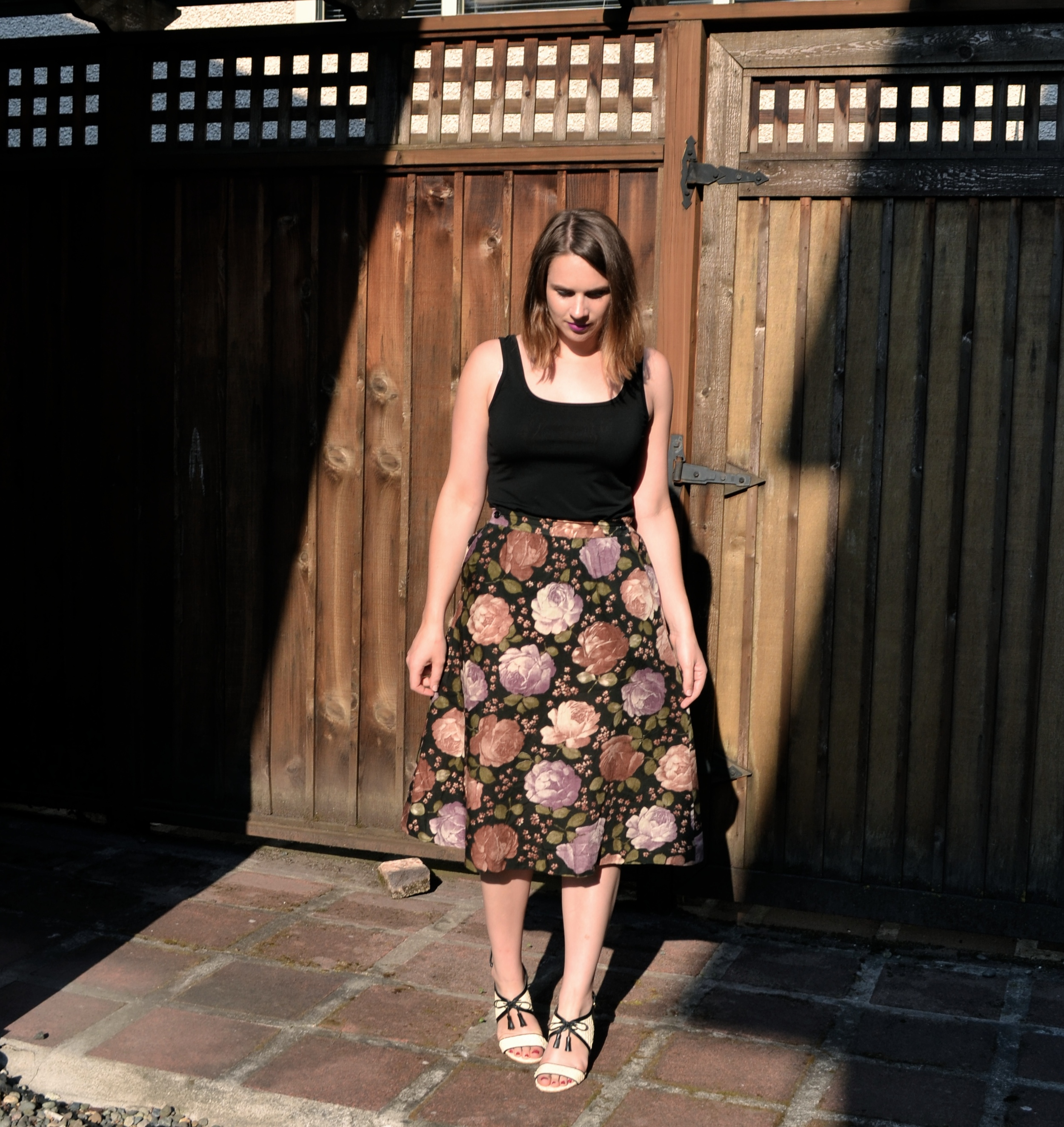 floral-skirt-white-heels-brown-fence
