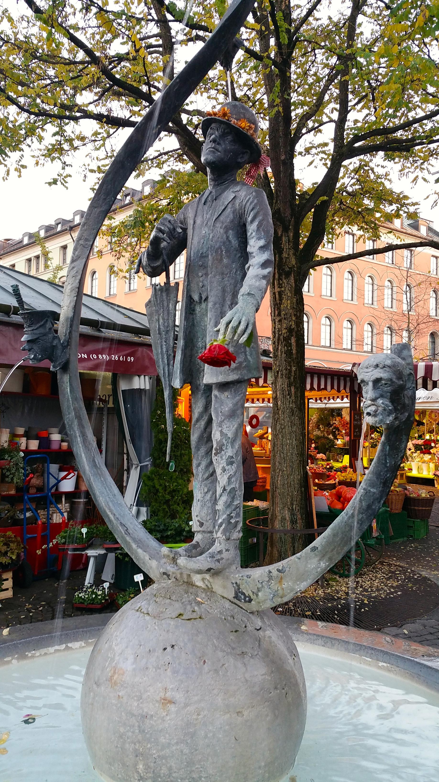 man-statue-water-fountain-munich