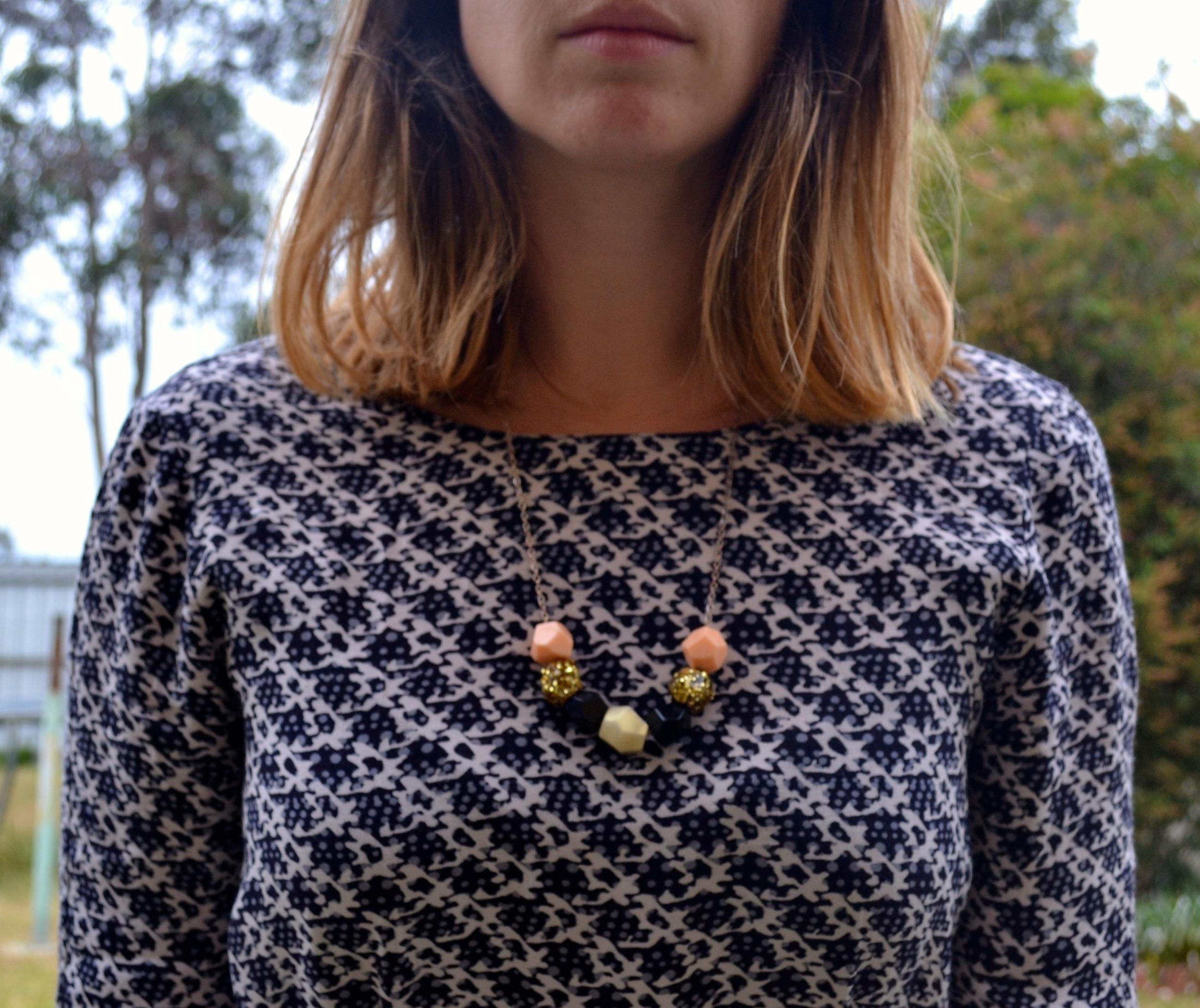 necklace-blue-playsuit-closeup