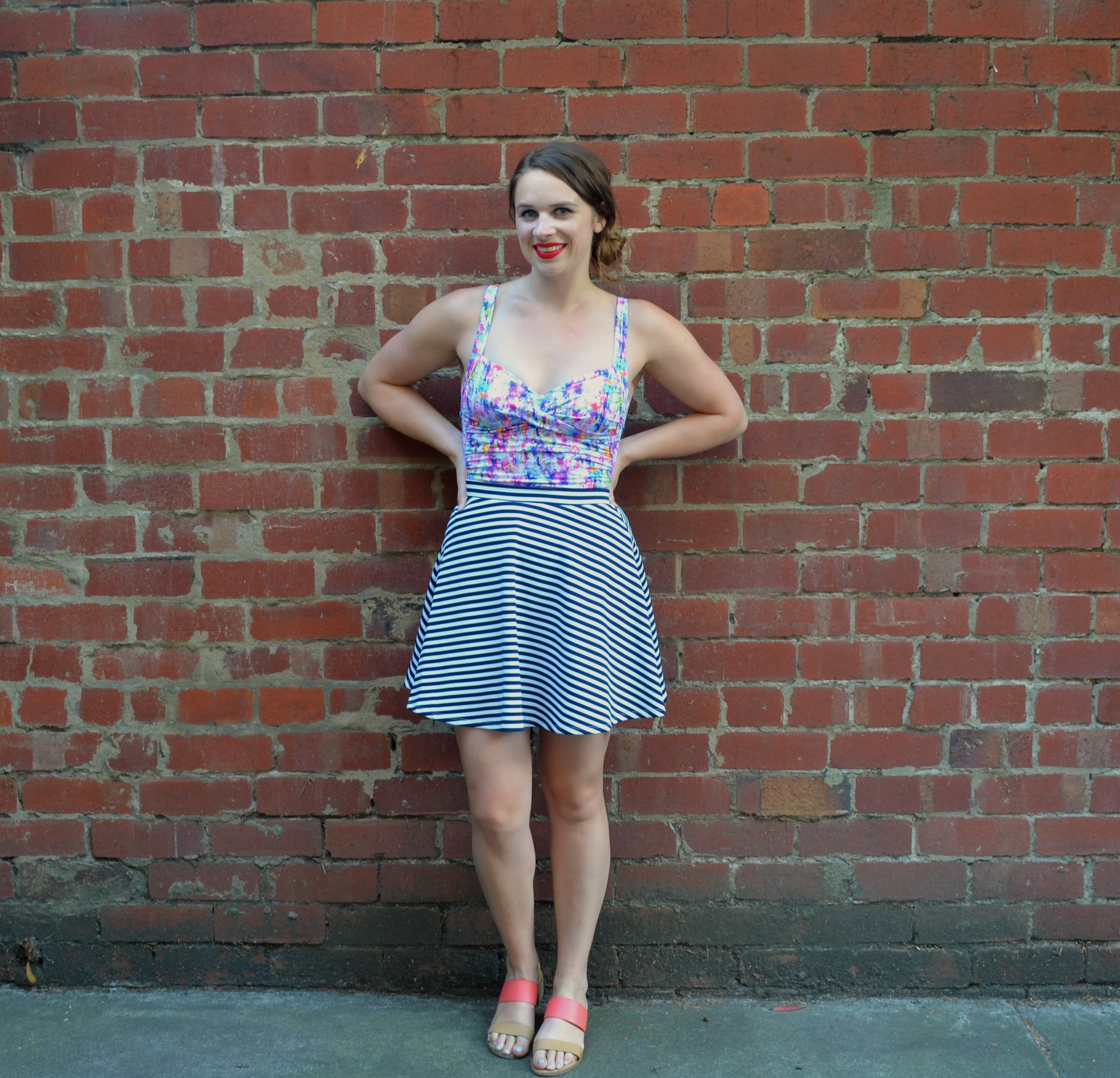 swimsuit-skirt-brick-wall
