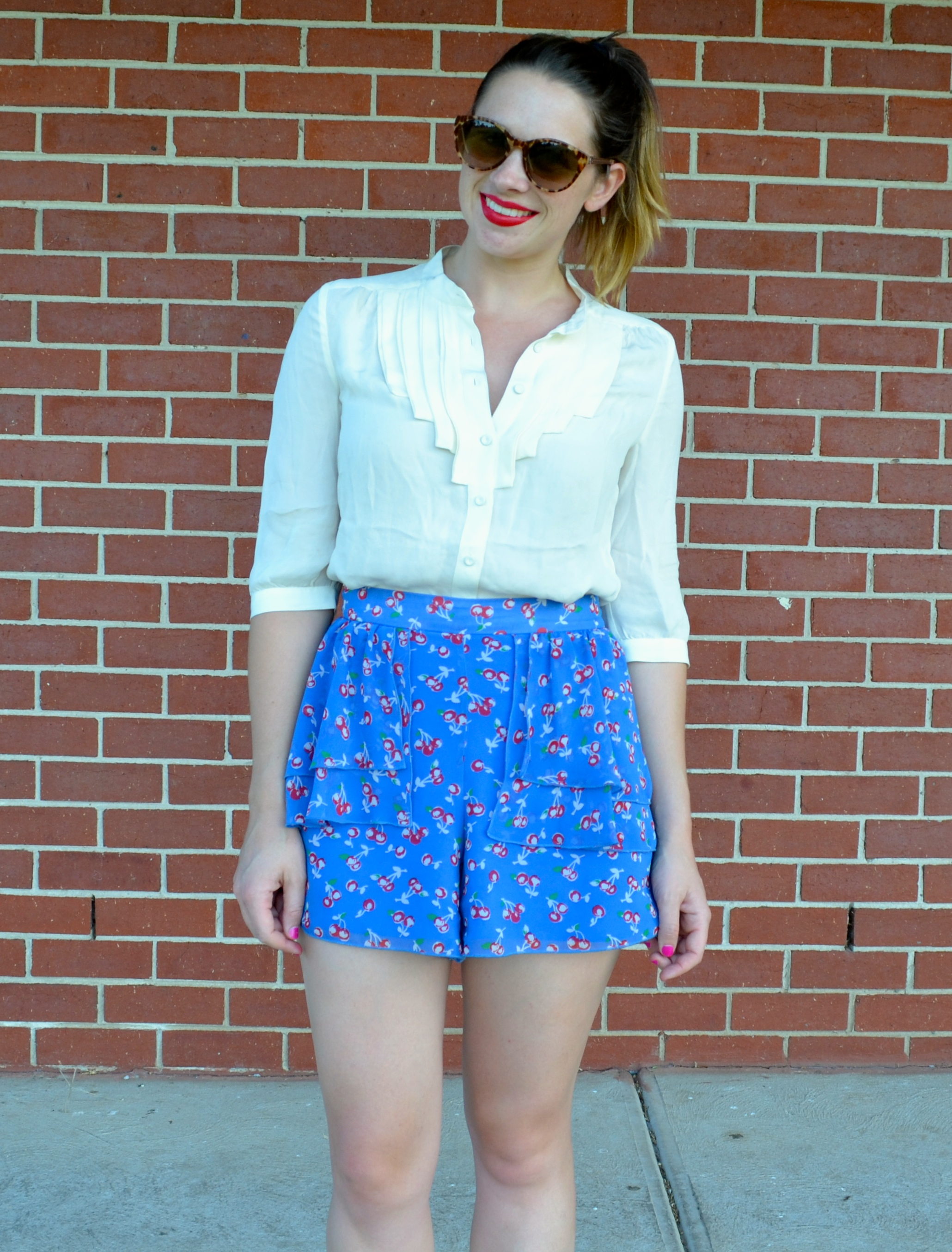 blue-red-shorts-white-shirt-red-lips-oroton-sunglasses
