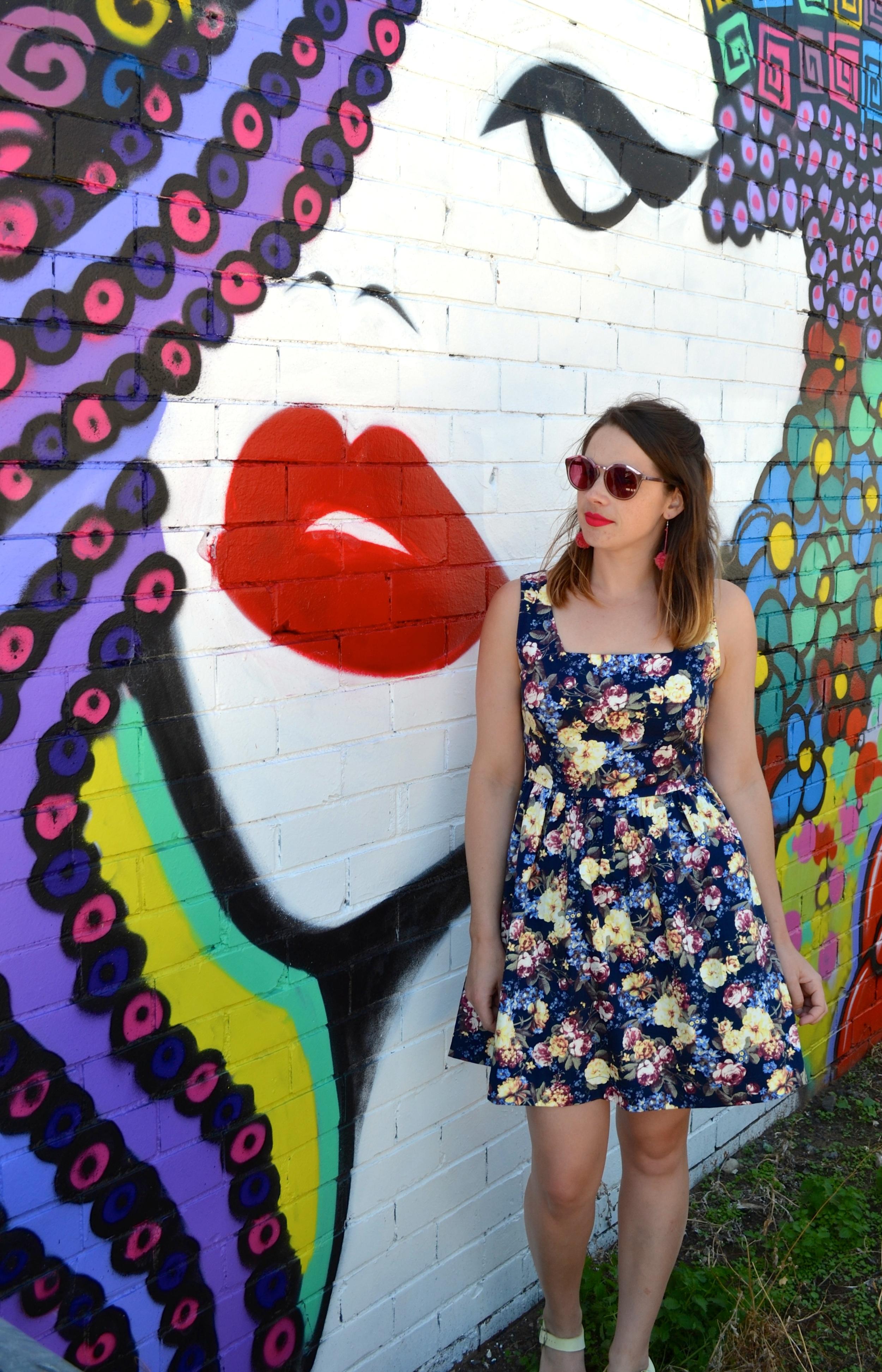 graffiti-woman-face-pom-pom-earrings-pink-sunglasses-bonlook