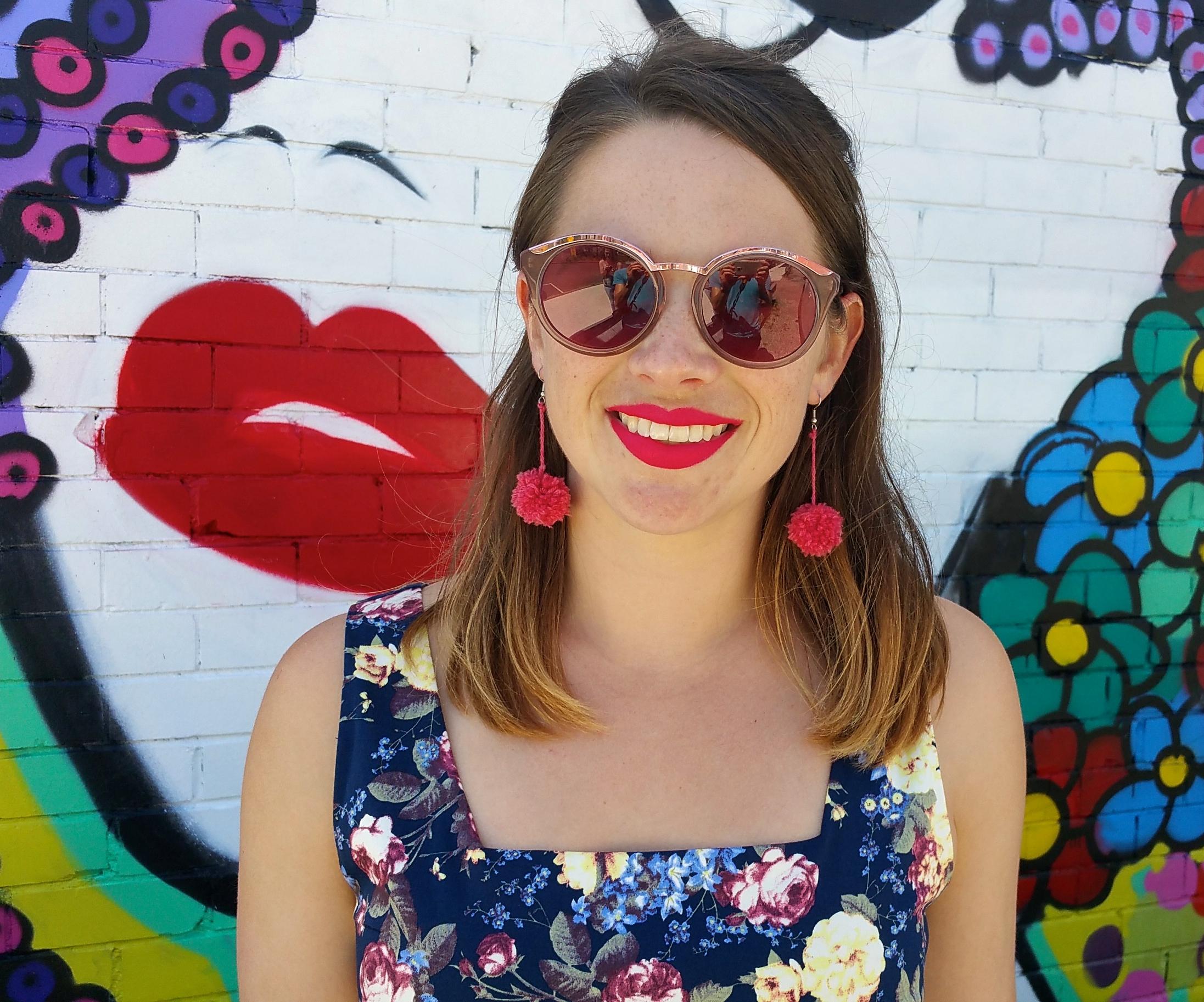 pom-pom-earrings-floral-dress-pink-refelctive-sunglasses