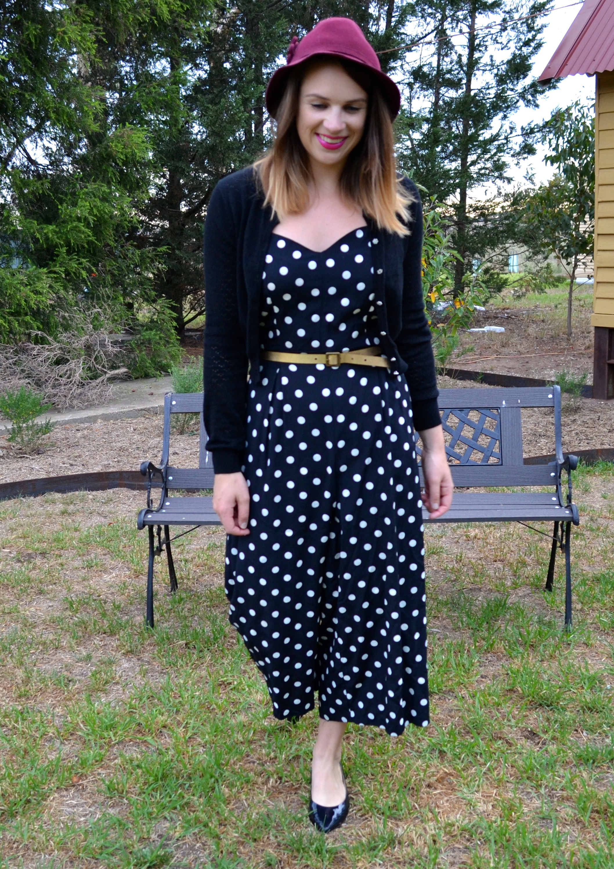 polka-dot-jumpsuit-gold-belt-black-flat-shoes